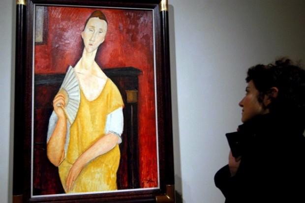 «Жінка з віялом» Амедео Модільяні. Одна із вкрадених робіт з Музею сучасного мистецтва в Парижі